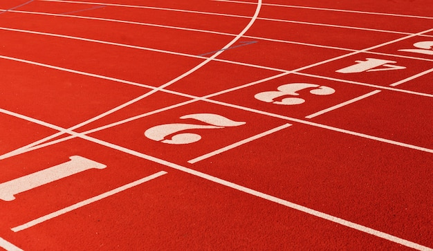 Stadium running track with red coating and numbers closeup