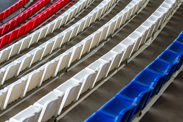 Stadium seats, france flag color. soccer, football or baseball stadium tribune without fans.