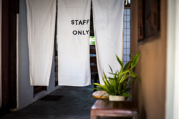 Staff only sign, at the door made from white fabric to keeping confidential
