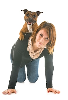 Staffordshire bull terrier and woman
