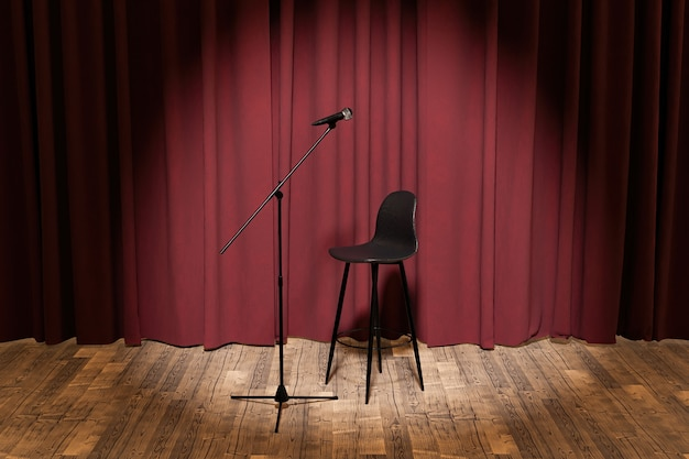 Stage illuminated by spotlight with stool and microphone and curtain backdrop