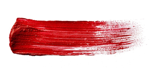 Stain swatch of a red matte lipstick on white background