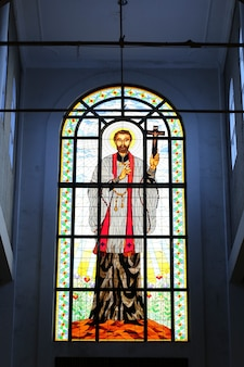 Stained glass windows depicting sacred heart of jesus at cathedral in jogjakarta