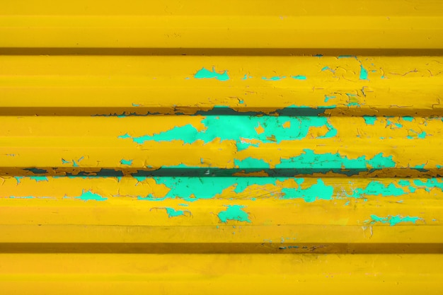 Stained yellow metal wall texture as space