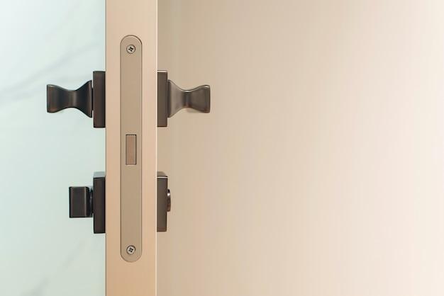 Stainless door knob. handle on wooden door, closeup. white wooden modern door