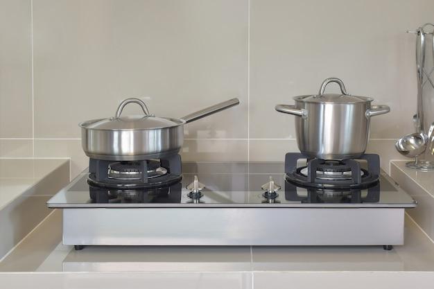 Stainless pots in modern kitchen
