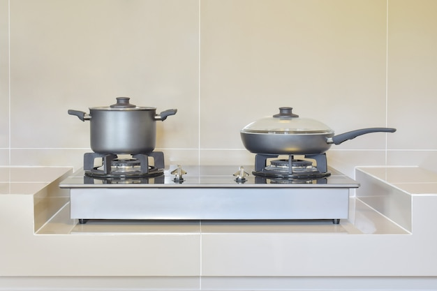 Stainless pots in modern kitchen