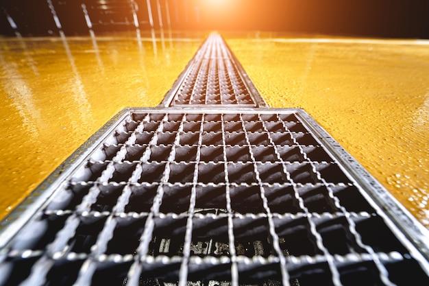 Stainless steel floor drain at a modern beer factory