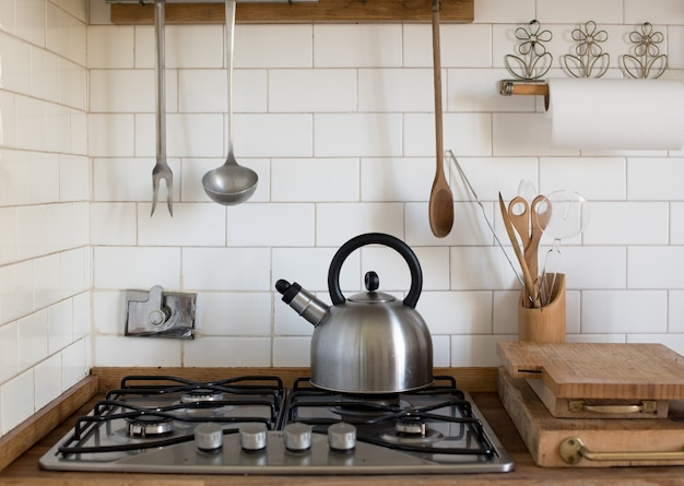 Stainless steel kettle on a gas burner