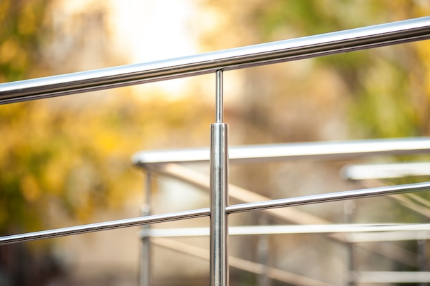 Stainless steel metal handrails near the building