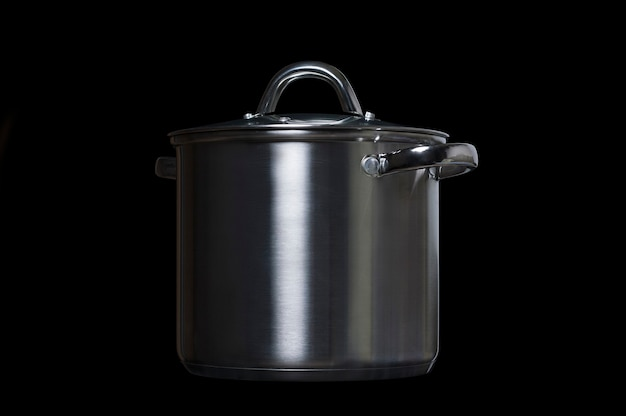 Stainless steel pan on a black background
