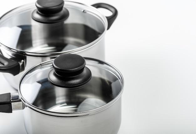 Изолированные кастрюли и сковородки из нержавеющей стали