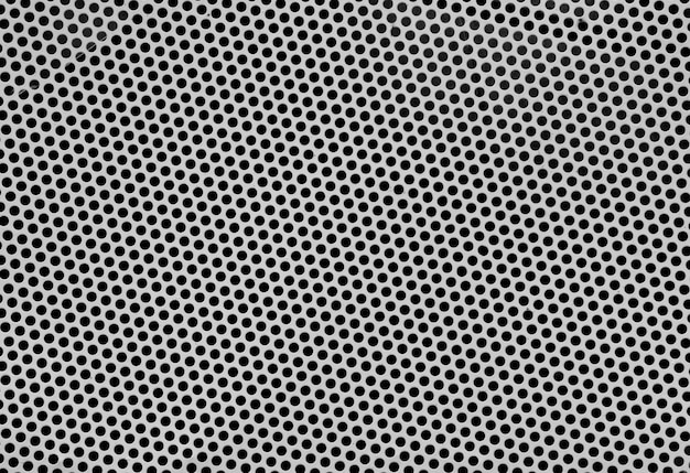 Stainless steel punched metal sheet texture - background