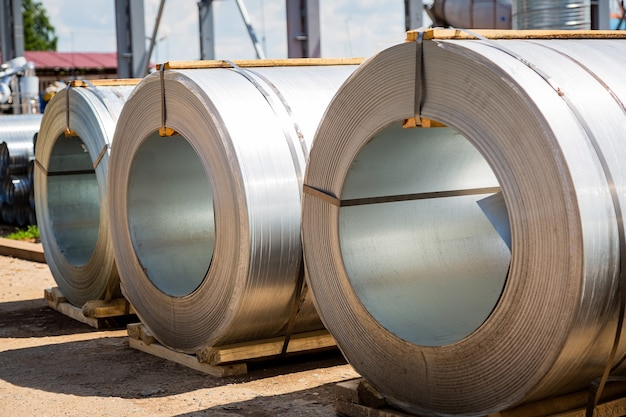 Stainless steel rolls. rolls of steel sheet in the warehouse. a roll of galvanized steel sheet for the production of metal pipes and tubes in a factory.