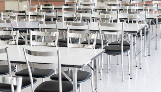 Stainless steel tables and chairs in high school student canteen
