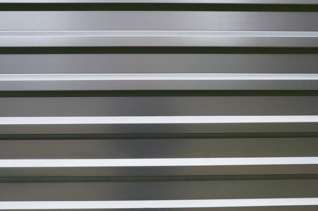 ステンレス鋼の壁の光沢のある背景のテクスチャ