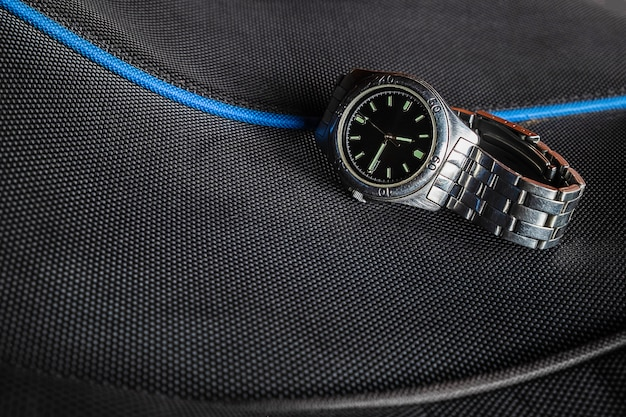 Stainless steel watch on a black background