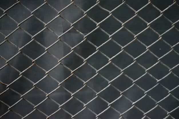 Stainless steel wire mesh with rust. background.