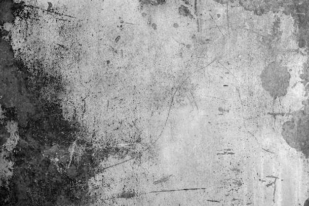 灰色の壁に汚れや傷。抽象的な灰色の背景。灰色の漆喰の質感。暗い粗面。