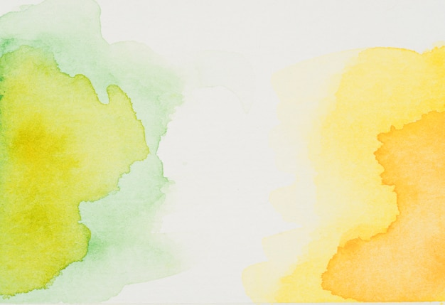 Stains of green and yellow watercolor
