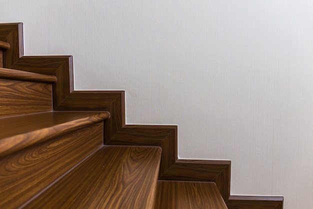 Staircase custom built home interior with wood staircase and white walls.