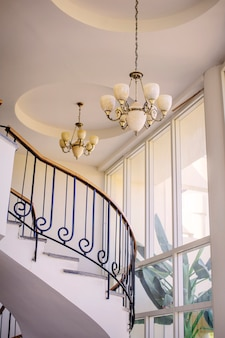 Staircase in the interior with chandeliers