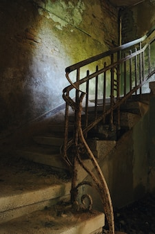 Staircase and railing in an old abandoned house