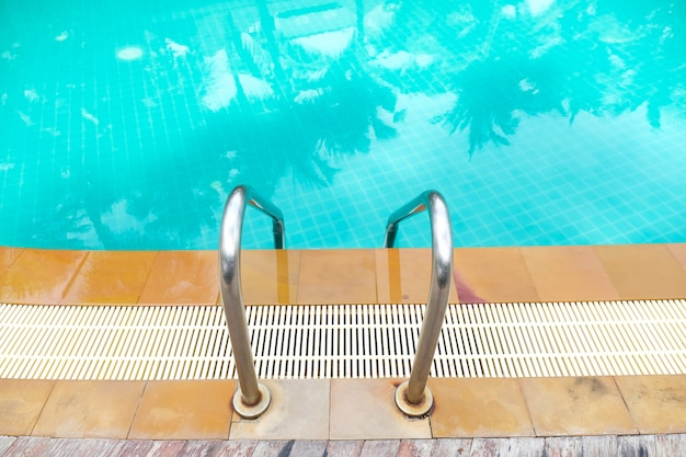 Stairs and ladders made of stainless steel for outdoor swimming pool.