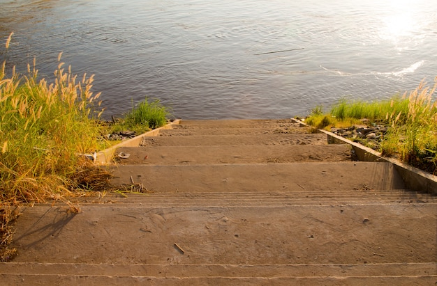 Stairs waterfront, walkway down to the river khong