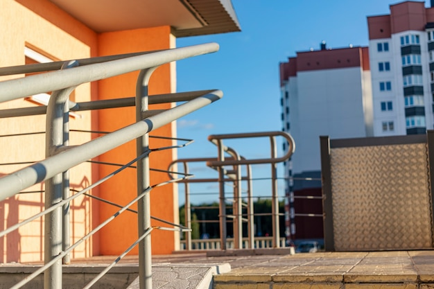 Stairway with metallic banister in a new modern building. railing at the entrance to an apartment building.