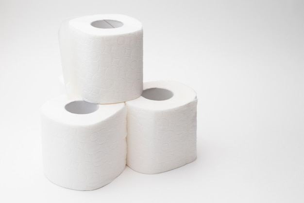 Stak of group rolls of toilet paper.
