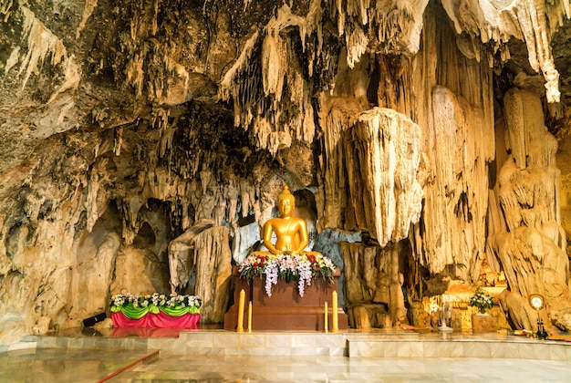 Stalactites and golden buddha at wat tham phu wa