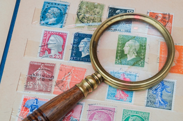 Stamp collection and vintage loupe