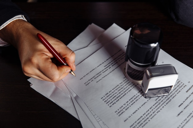 Stamp and contract on desk
