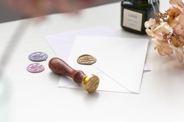 Stamp and envelopes on a light table with documents