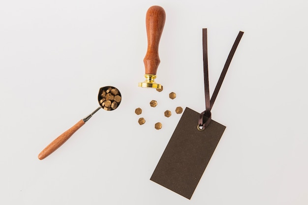 Stamp and various fittings are placed against a whitetextured background Premium Photo