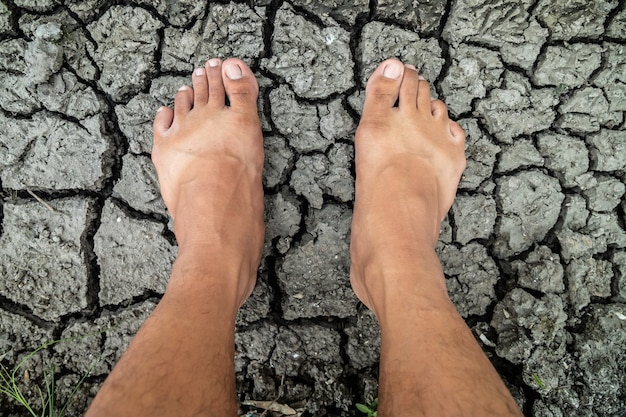 Stand barefoot on the cracked mud floor