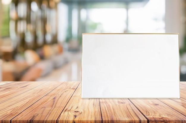 Stand mock up menu frame card or noticeboard on blurred background interior