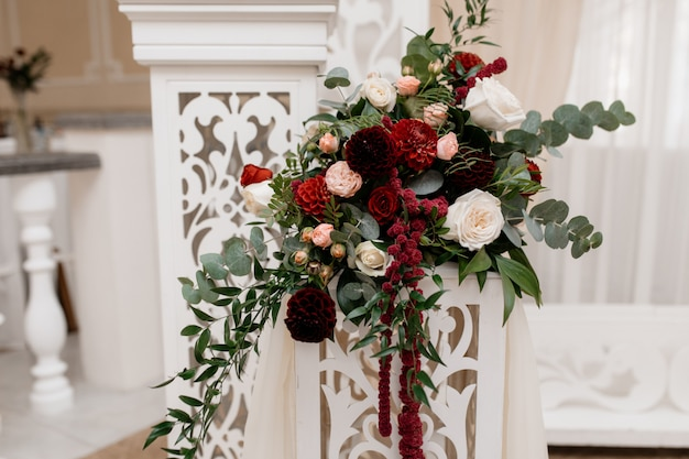 Stand with bouquet for wedding ceremony