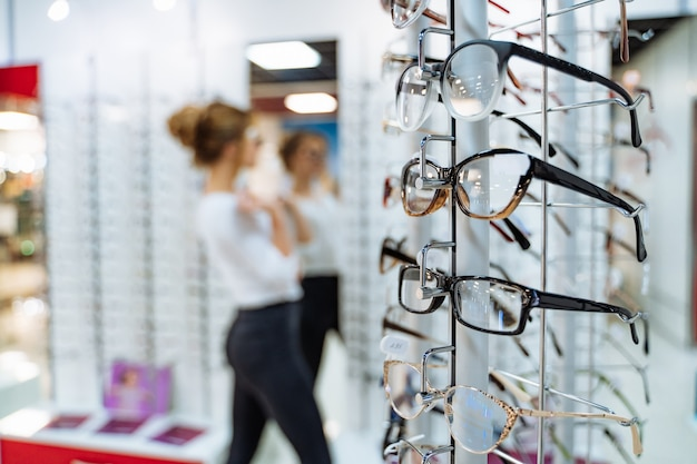 Stand with glasses in the store of optics