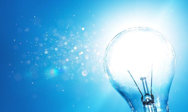 青い背景の標準的な白熱電球