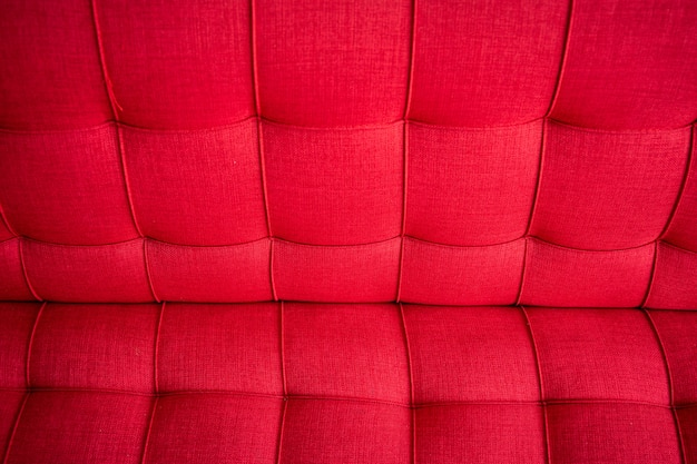 Standard sofa in the red color close up.