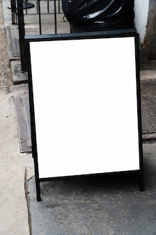 Standing billboard template in front of shop