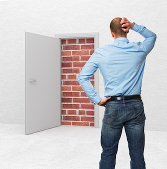 Standing business man and closed door