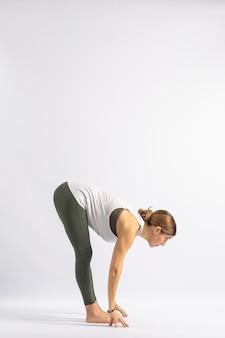 Standing forward bend (uttanasana b) yoga postures (asana)
