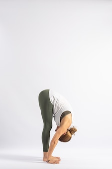 Standing forward bend (uttanasana a) yoga postures (asana)
