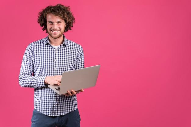 Standing man using laptop
