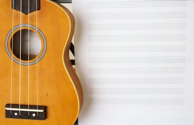 Standing music sheet and ukulele