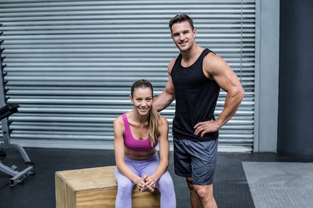 Standing and sitting muscular couple