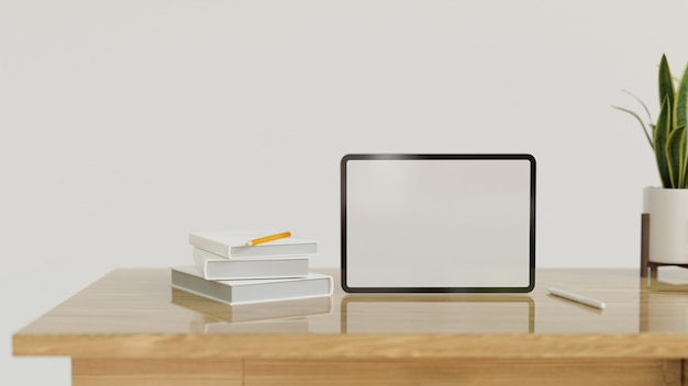 Standing tablet computer in blank screen with decor on modern wood table with copy space